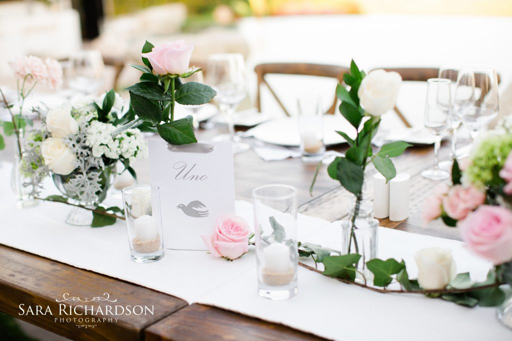 whimsical and classy table settings at a romantic beach wedding