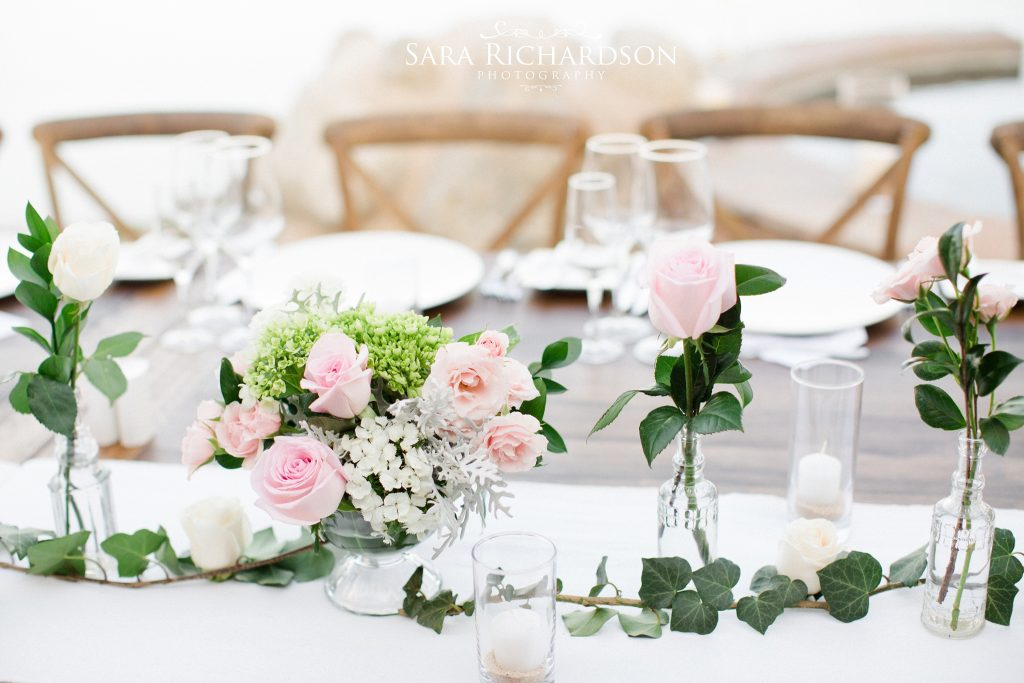 romantic beach wedding used delicate shades of pink roses for tables