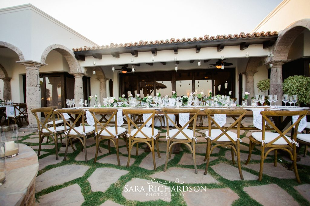 banquet style dining at this romantic beach wedding