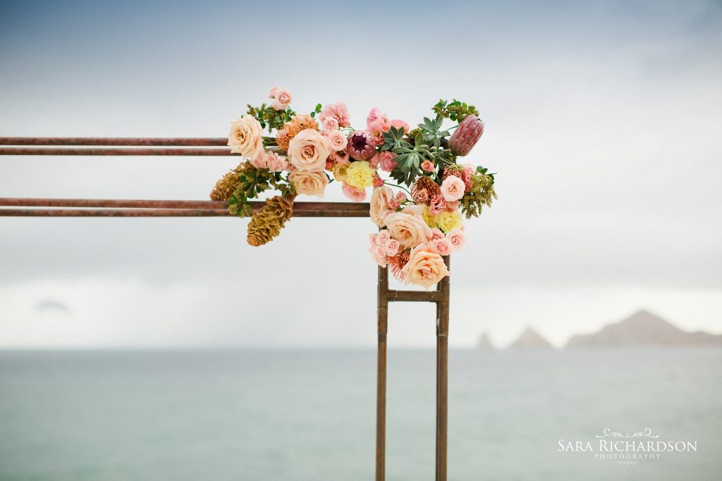 beautiful floral design on the arbor of this modern wedding
