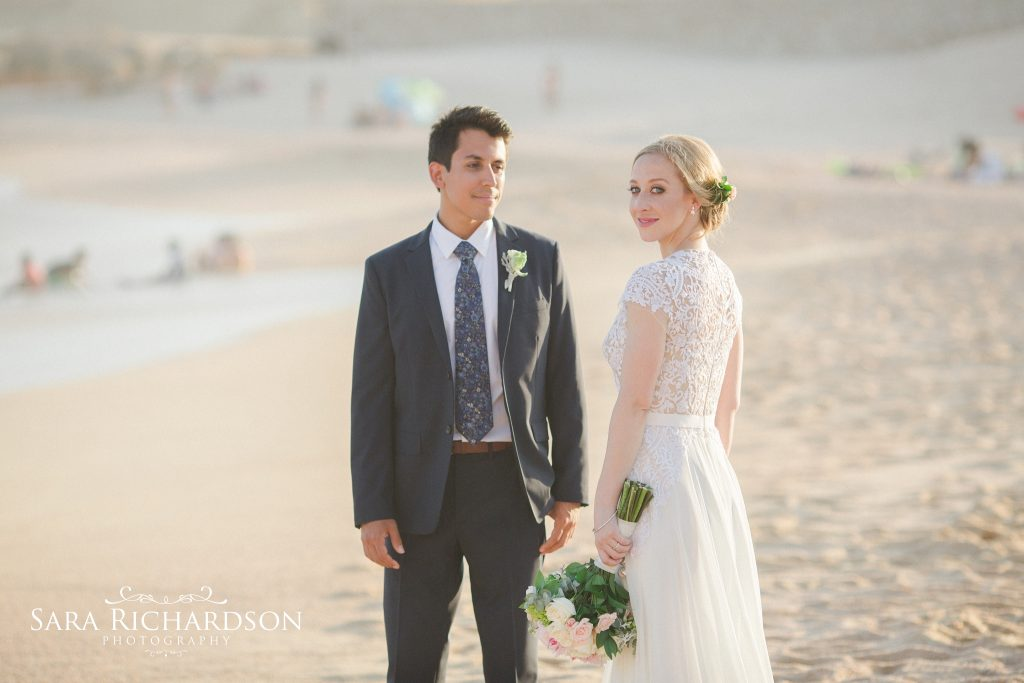 bride & groom during their romantic beach wedding