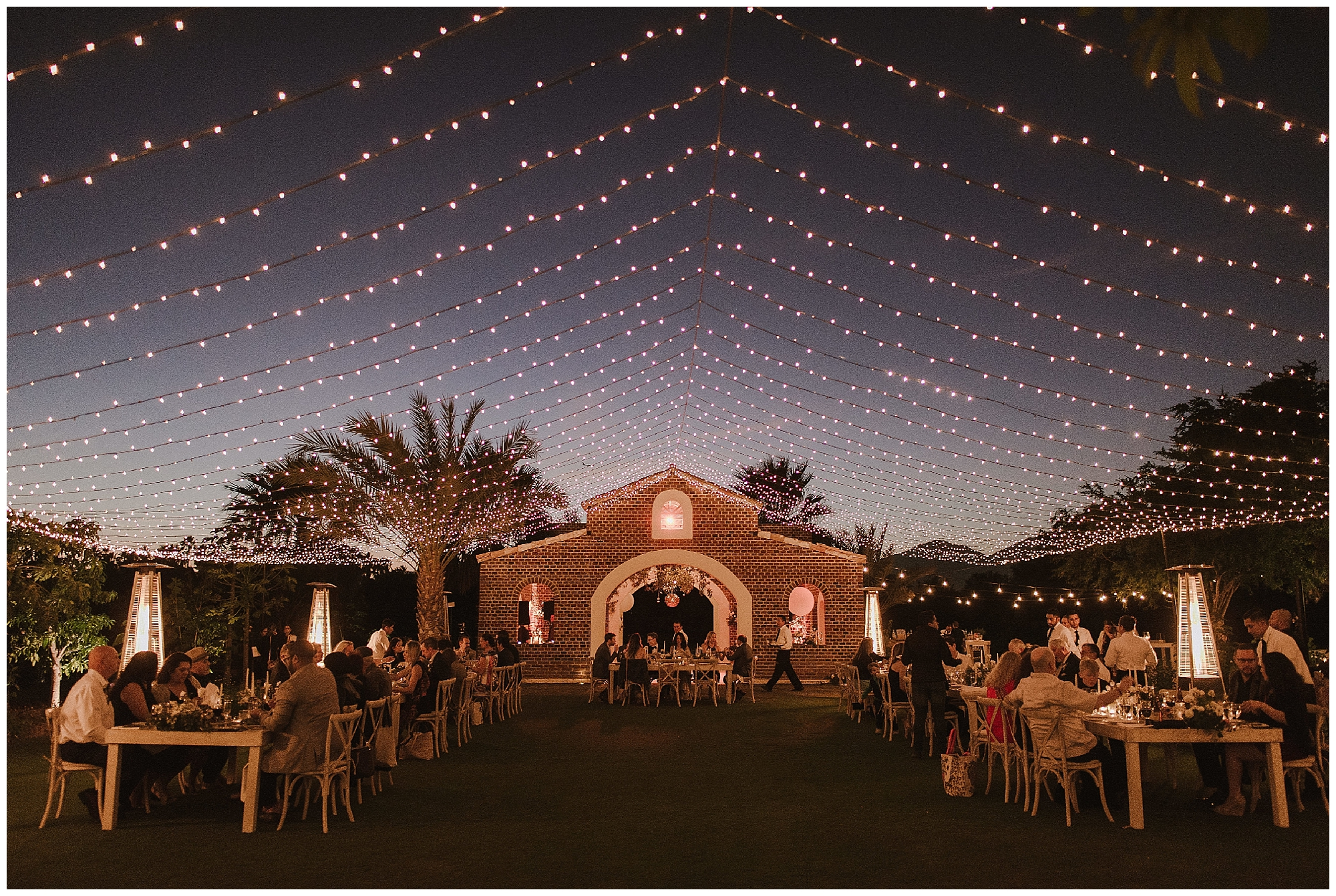 Wow - the lighting looks like stars in the sky - truly a beautiful Cabo wedding celebration