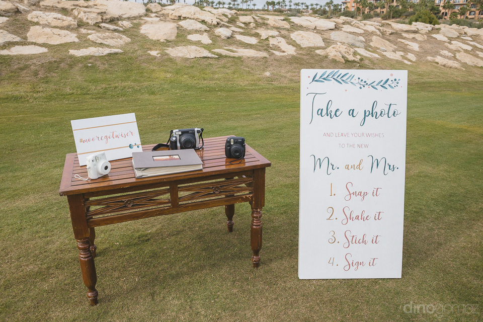 fun Polaroid station set up for Cabo del Sol wedding weekend
