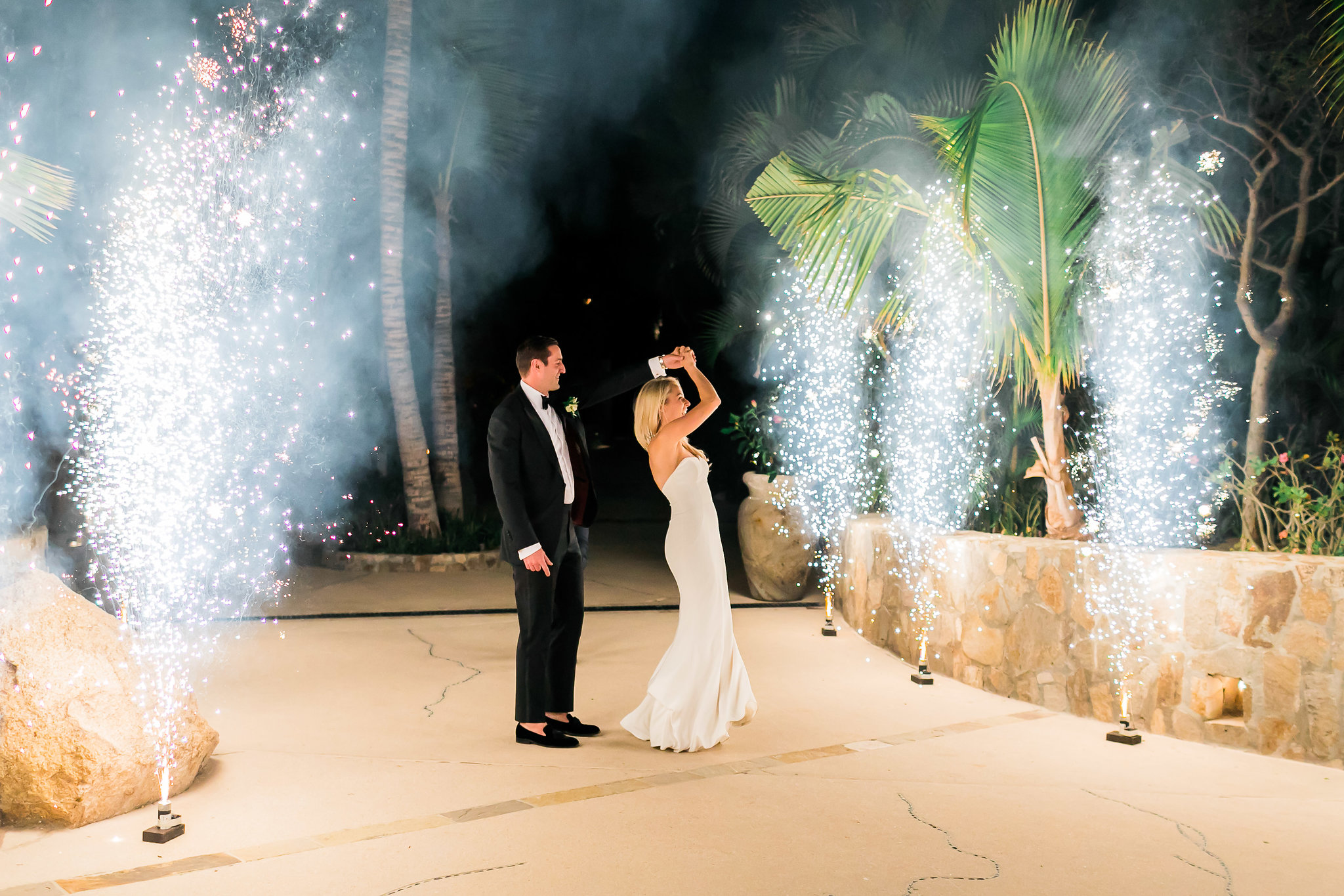 amazing fireworks entrance to reception at White Wedding At The One & Only Palmilla