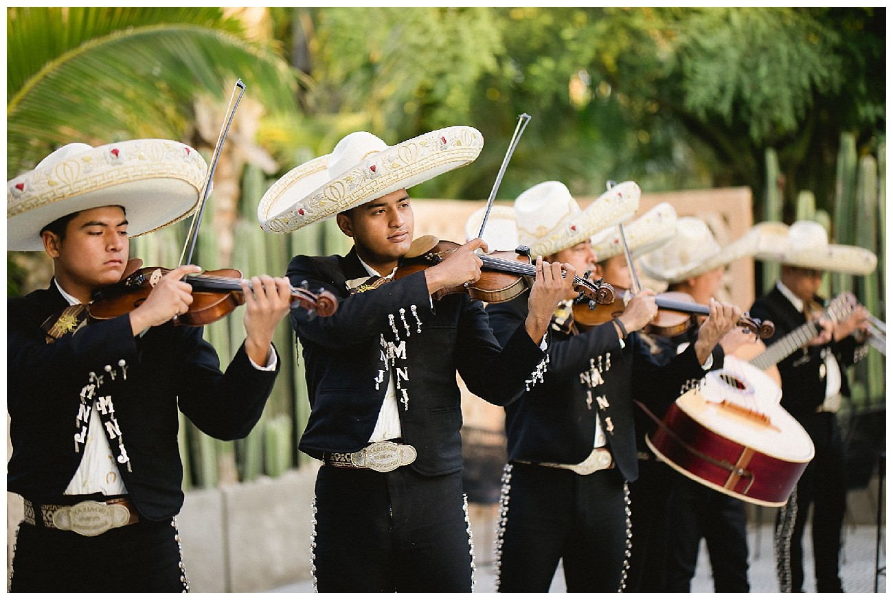 traditional mariachis play at a wedding rehearsal dinner the night before a wedding at JW Marriott