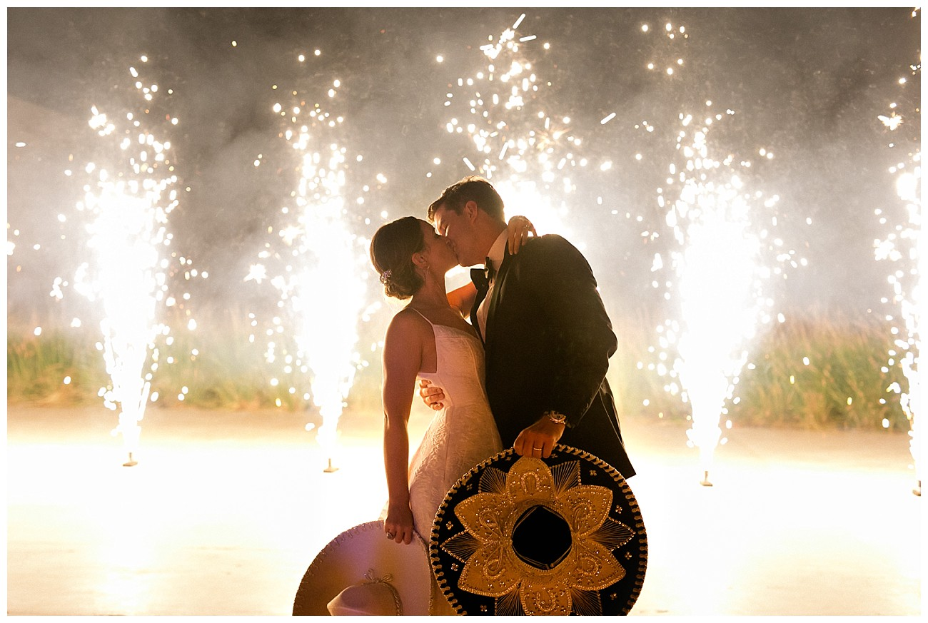 fire works display and sombreros in hand at a wedding at JW Marriott San Jose del Cabo