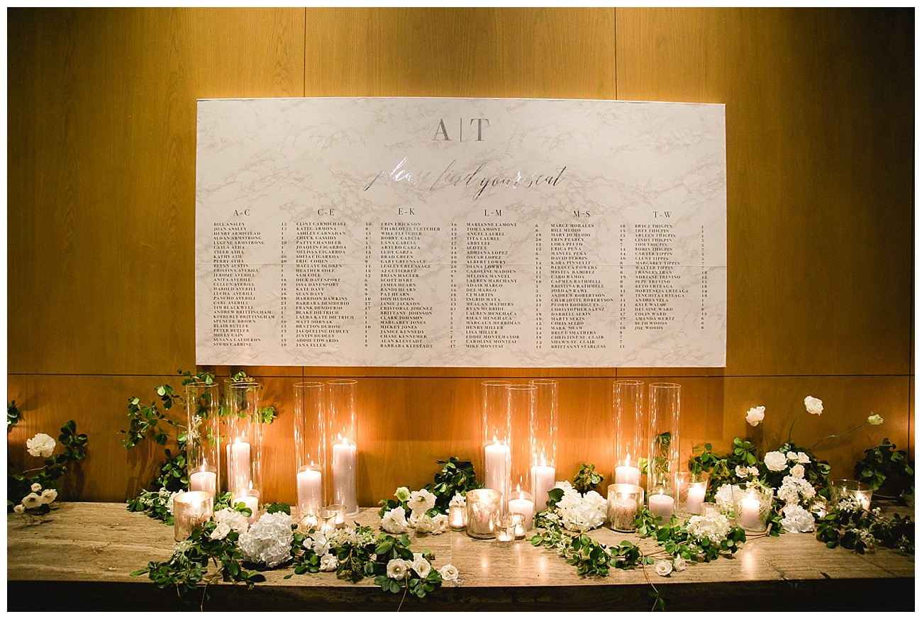 table settings on the wall for wedding at JW Marriott San Jose del Cabo