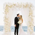 white-themed wedding arch at Chileno Bay wedding
