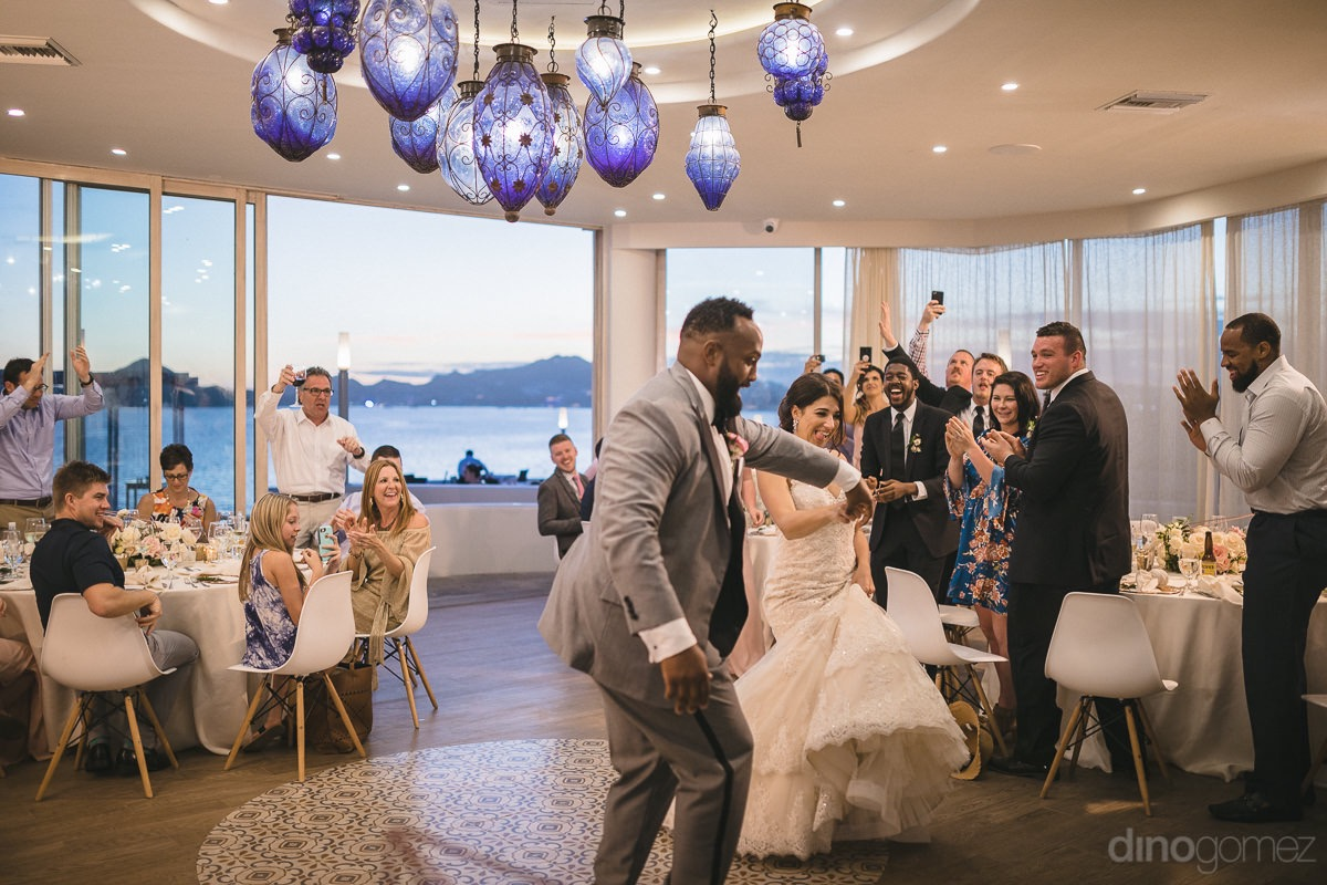 bride and groom dancing at their destination wedding in Cabo