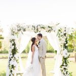 bride and groom during their white wedding at Flora Farms