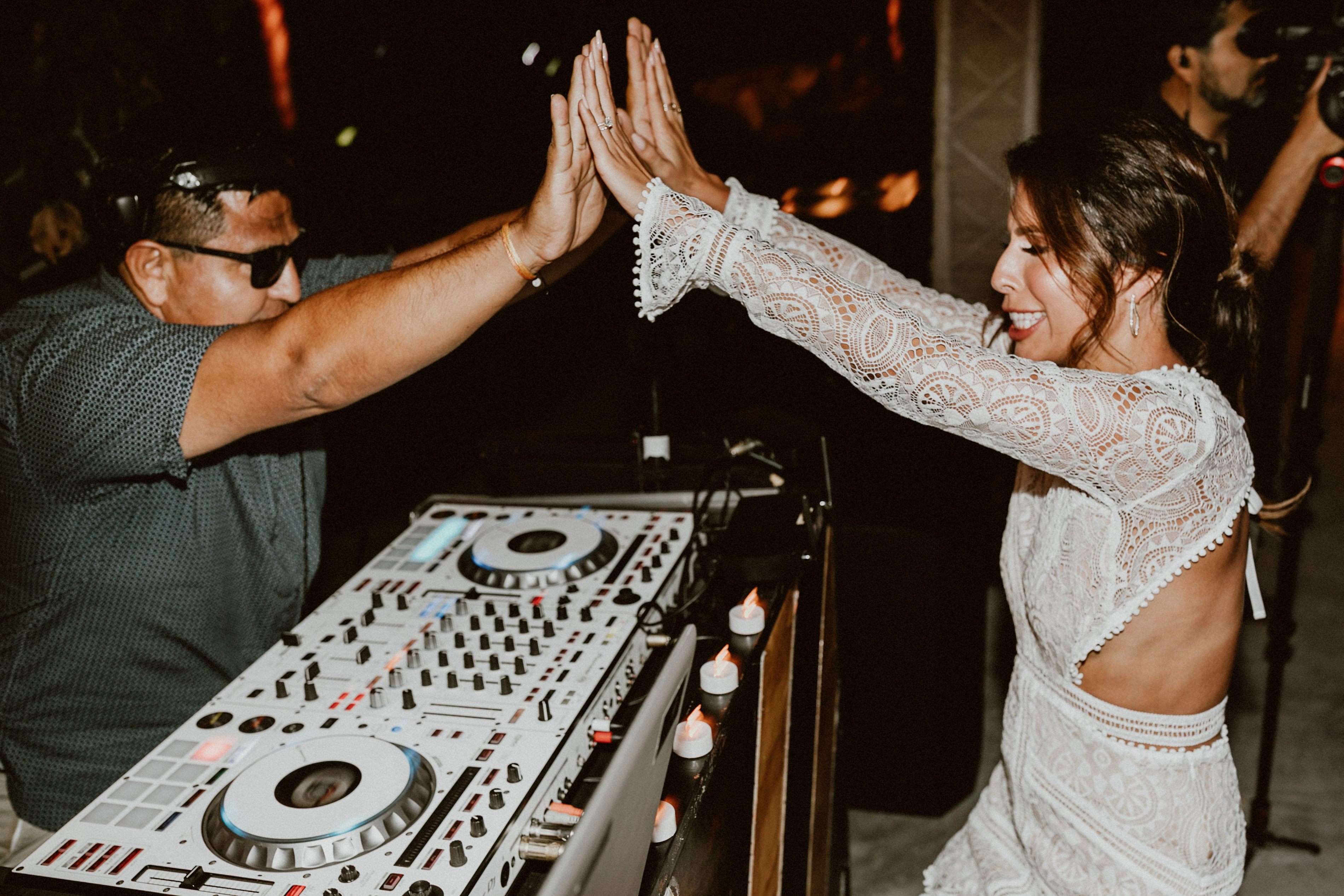 the DJ plays at a Cabo destination wedding