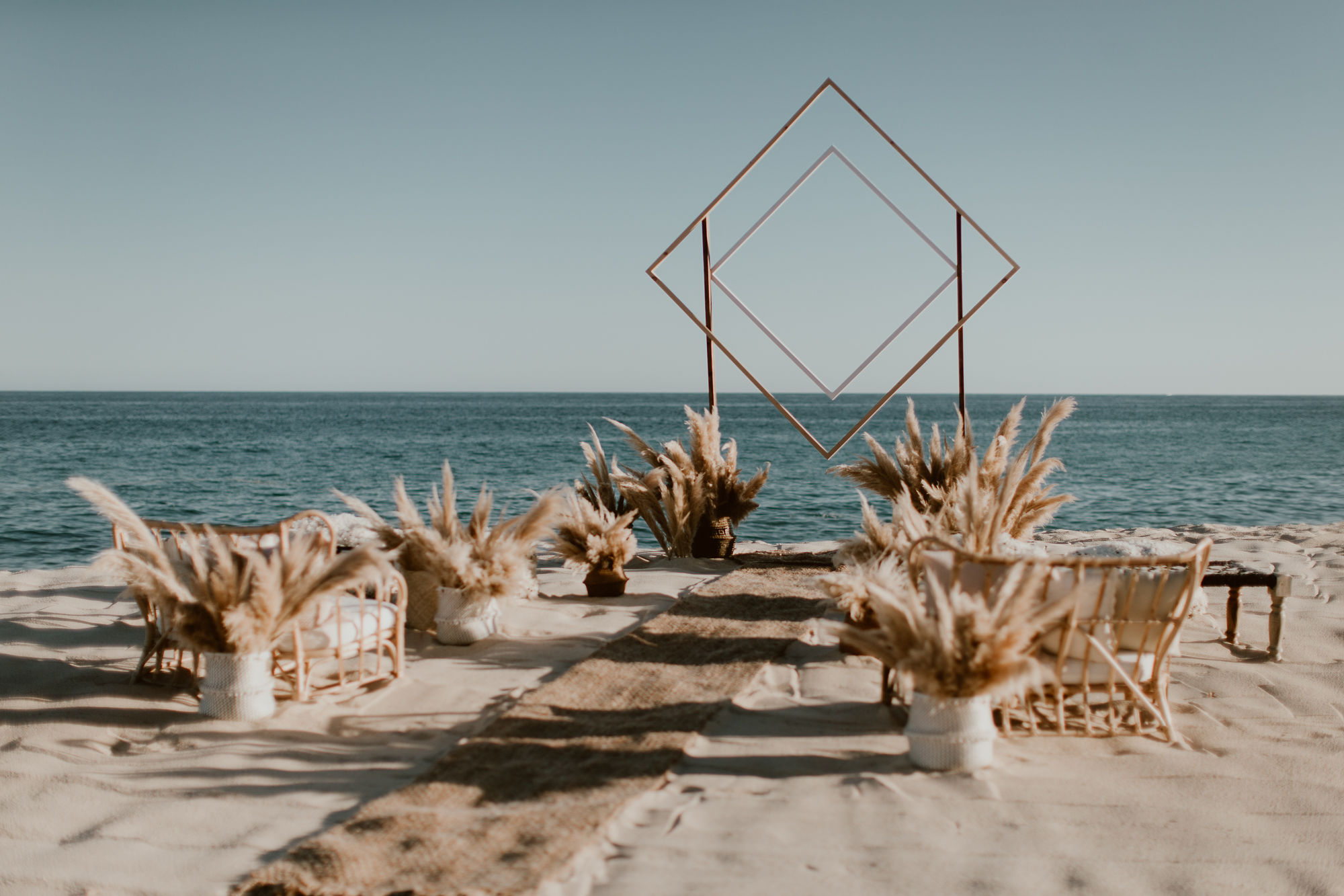 boho chic wedding arbor at a Cabo destination wedding