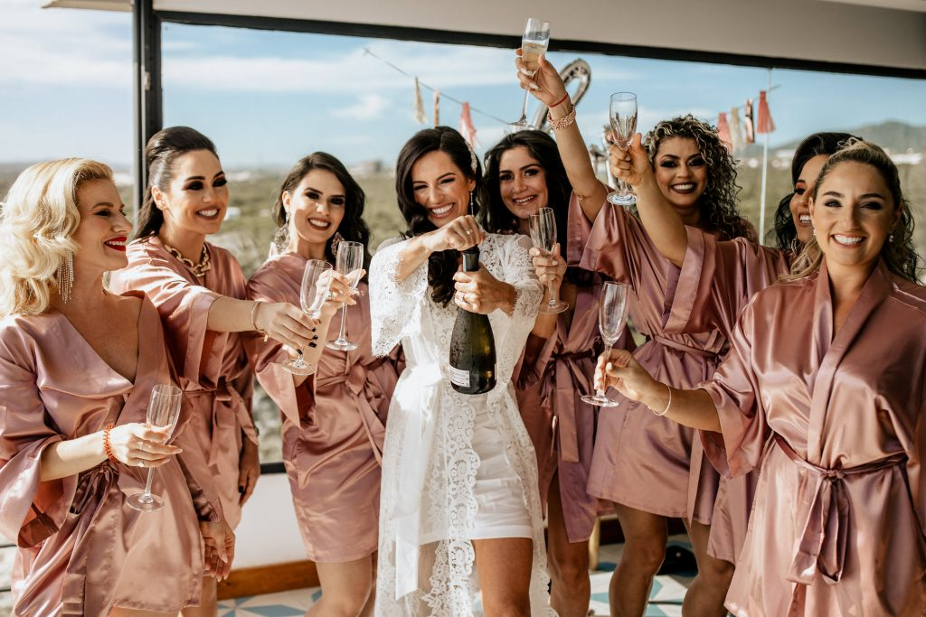 the bridal party getting ready - the funnest part of the wedding day timeline!